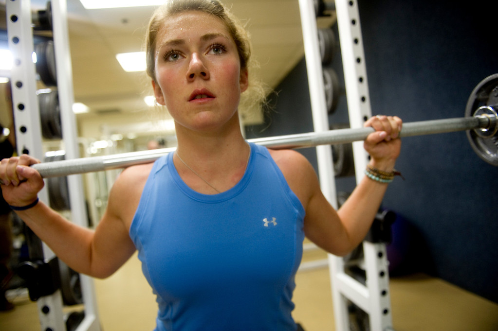 . Olympic downhill skier Mikaela Shiffrin squats during a morning workout at the Homestead Club in Edwards, Co. on July 15, 2013. (Photo By Grant Hindsley/The Denver Post)