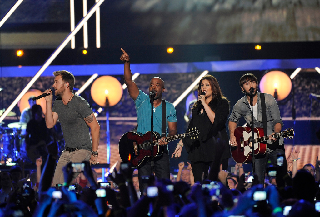. Darius Rucker, third from right, and from left, Charles Kelley, Hillary Scott and Dave Haywood, of Lady Antebellum, perform at the 2013 CMT Music Awards at Bridgestone Arena on Wednesday, June 5, 2013, in Nashville, Tenn. (Photo by Donn Jones/Invision/AP)