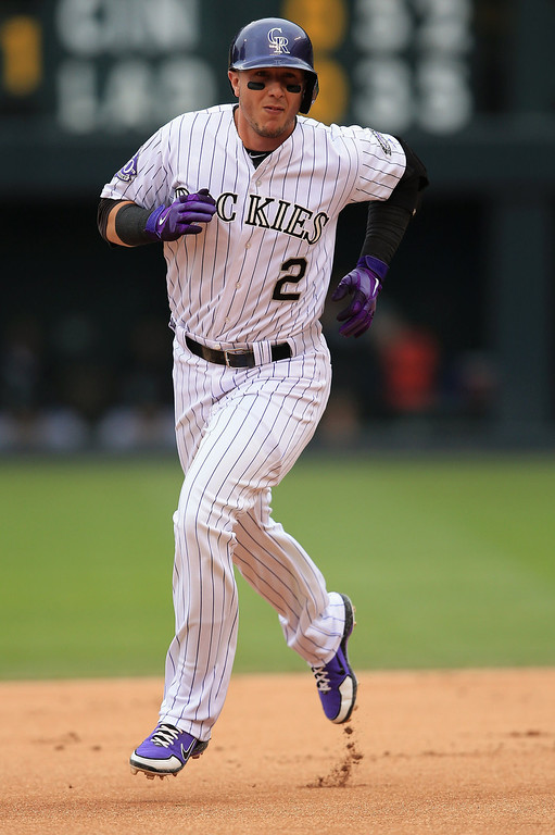 . Troy Tulowitzki #2 of the Colorado Rockies rounds the bases on his solo home run off of starting pitcher Donovan Hand #48 of the Milwaukee Brewers in the first inning at Coors Field on July 28, 2013 in Denver, Colorado.  (Photo by Doug Pensinger/Getty Images)