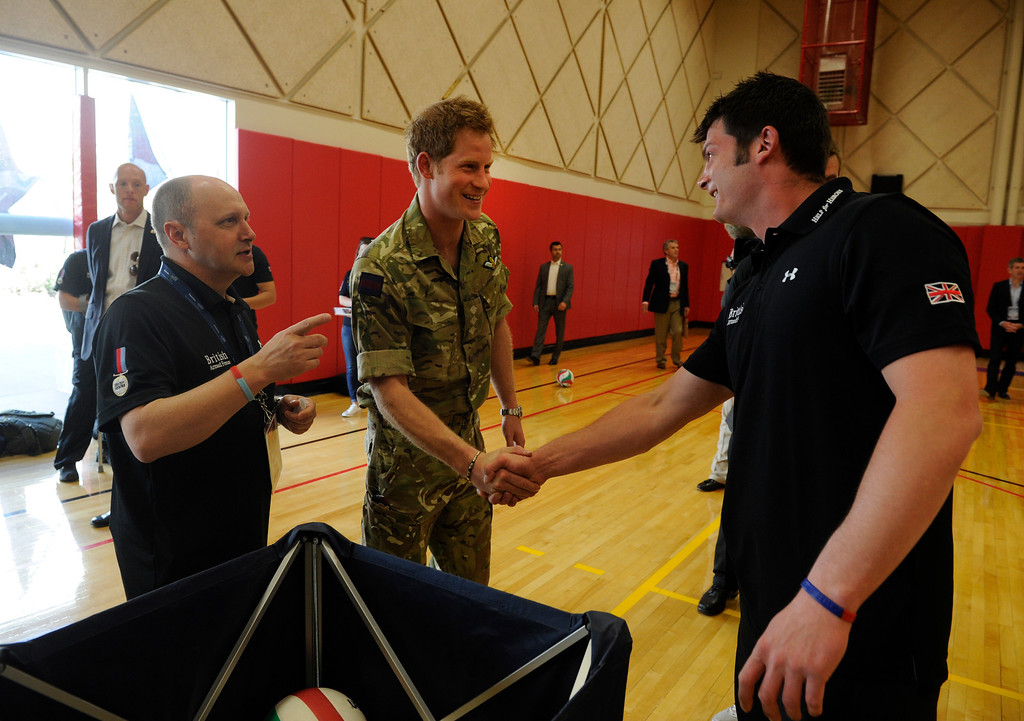 . COLORADO SPRINGS, CO - MAY 11: Britain\'s Prince Harry greets Capt. Dave Hensen, right, British Armed Services, Army Capt. and Warrior Games athlete at the United States Olympic Training Center  for the 2013 Warrior Games Saturday morning, May 11th, 2013. British Armed Forces team leader/coach, Martin Colclough, left, makes introductions. (Photo By Andy Cross/The Denver Post)