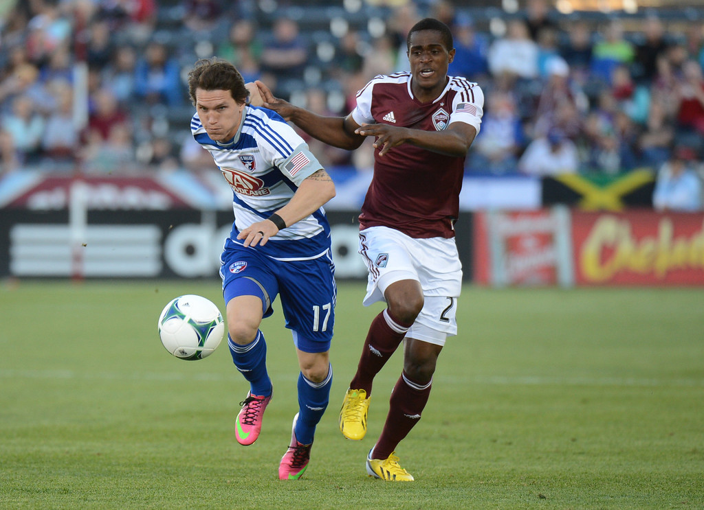 . COMMERCE CITY, CO. - June 01: Deshorn Brown of Colorado Rapids and Zach Loyd of FC Dallas (17) are chasing the ball in the first half of the game at Dick\'s Sporting Goods Park. Commerce City, Colorado. June 1, 2013. (Photo By Hyoung Chang/The Denver Post)