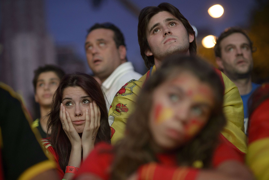 . Spain\'s supporters react while watching the 2014 FIFA World Cup football match between Spain and Netherlands on a giant screen near the Santiago Bernabeu stadium in Madrid on June 13, 2014. DANI POZO/AFP/Getty Images