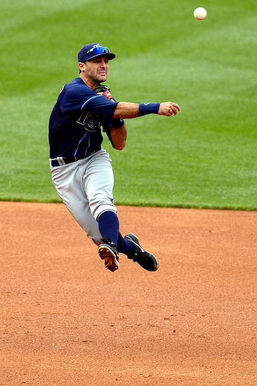 . DENVER, CO - MAY 5: Sean Rodriguez (1) of the Tampa Bay Rays makes an acrobatic throw, but failed to get Josh Rutledge (14) of the Colorado Rockies out during the Rockies\' 8-3 loss.   (Photo by AAron Ontiveroz/The Denver Post)