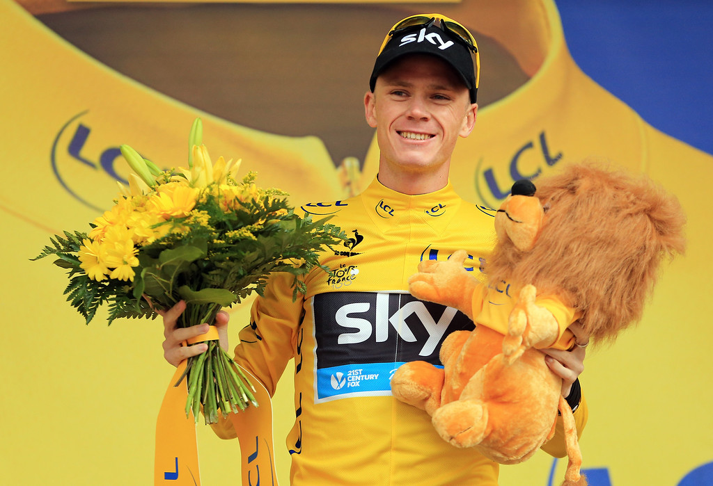 . Chris Froome of Great Britain and Team Sky Procycling celebrates on the podium as he retains the yellow jersey following  during stage nineteen of the 2013 Tour de France, a 204.5KM road stage from Bourg d\'Oisans to Le Grand Bornand, on July 19, 2013 in Le Grand Bornand, France.  (Photo by Doug Pensinger/Getty Images)