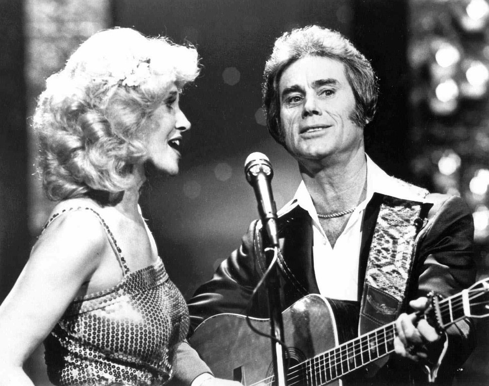 ". In this undated photo, Tammy Wynette, left, sings with George Jones in Nashville.   Jones, the peerless, hard-living country singer who recorded dozens of hits about good times and regrets and peaked with the heartbreaking classic ""He Stopped Loving Her Today,\"" has died. He was 81. Jones died Friday, April 26, 2013 at Vanderbilt University Medical Center in Nashville after being hospitalized with fever and irregular blood pressure, according to his publicist Kirt Webster. (AP Photo/The Tennessean)"
