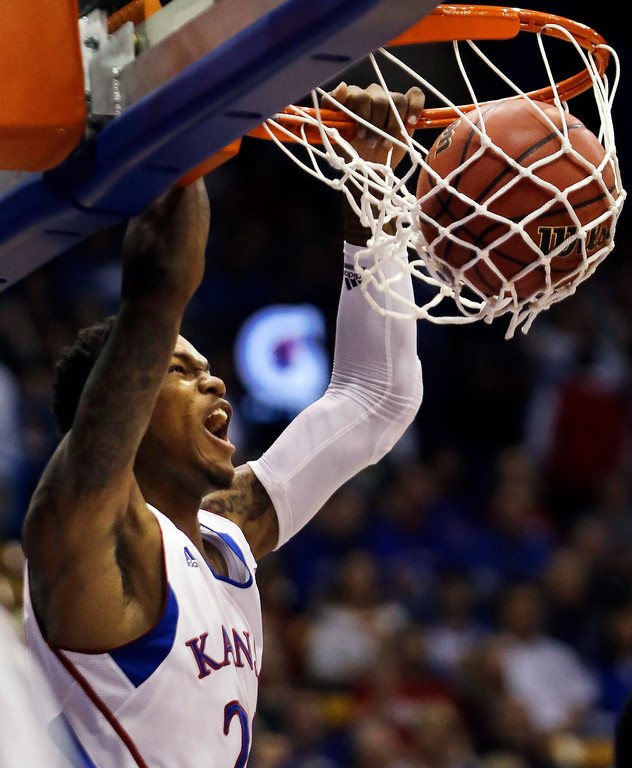 . Kansas guard Ben McLemore (23) dunks during the first half of an NCAA college basketball game against Richmond in Lawrence, Kansas, in November 2012. McLemore was picked in the first round of the 2013 NBA Draft by the Sacramento Kings.  (AP Photo/Orlin Wagner)