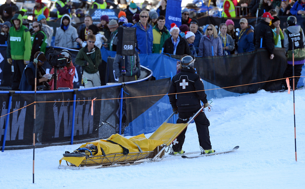 . ASPEN, CO. - JANUARY 27:  Medical staff takes Ashley Battersby down the mountain after she crashed during the Ski Slopestyle Women\'s Final, January 27, 2013. The 2013 Winter X Games at Buttermilk Mountain in Aspen. (Photo By RJ Sangosti / The Denver Post)