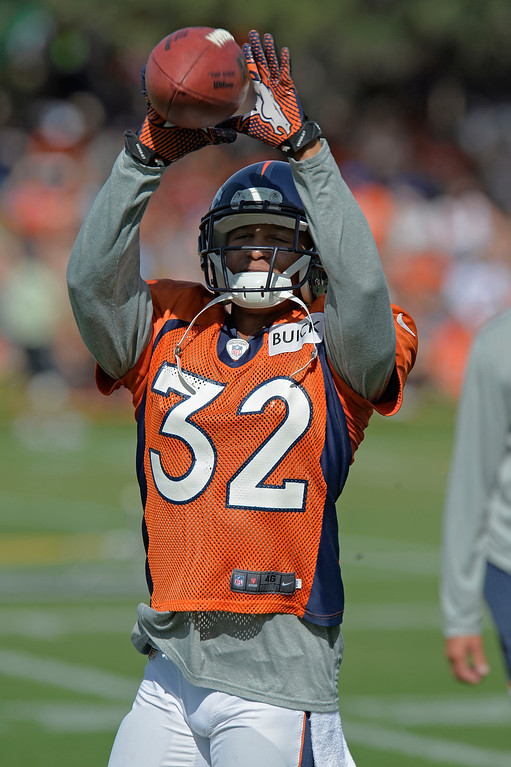 . Denver Broncos CB Tony Carter (32) catches a pass in drills during training camp August 6, 2013 at Dove Valley. (Photo By John Leyba/The Denver Post)