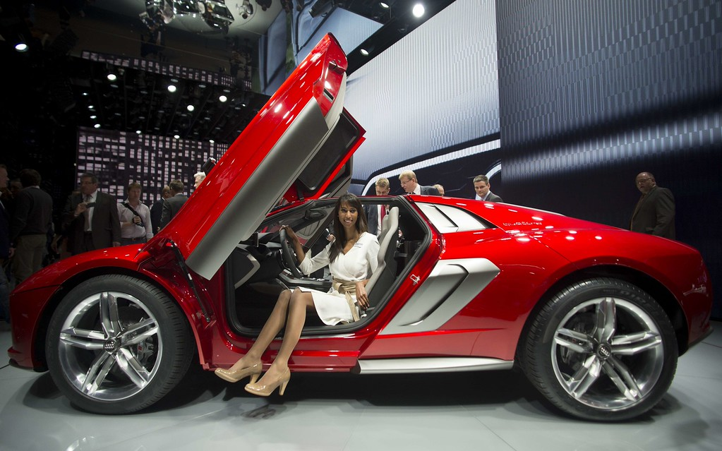 . A  model poses in an Audi Nanuk Quattro concept car during the media day of the IAA (Internationale Automobil Ausstellung) international motor show in Frankfurt am Main, western Germany, on September 10, 2013.     AFP PHOTO / JOHANNES EISELE/AFP/Getty Images