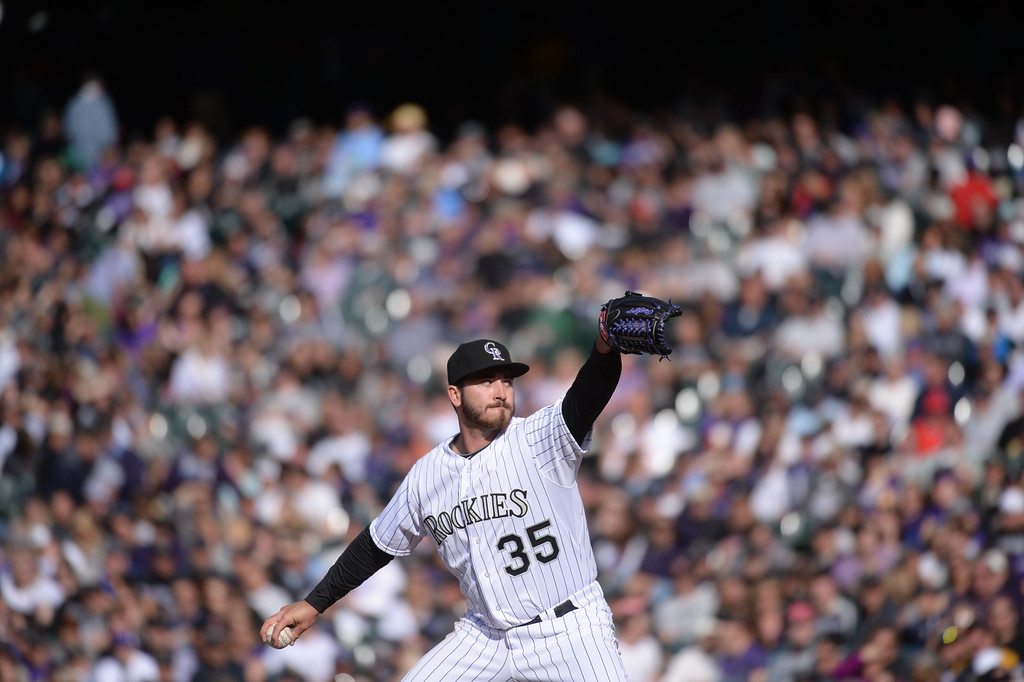 . Rockies reliever Chad Bettis pitches during the eighth inning. The Colorado Rockies hosted the Arizona Diamondbacks in the Rockies season home opener at Coors Field in Denver, Colorado Friday, April 4, 2014. (Photo by Karl Gehring/The Denver Post)