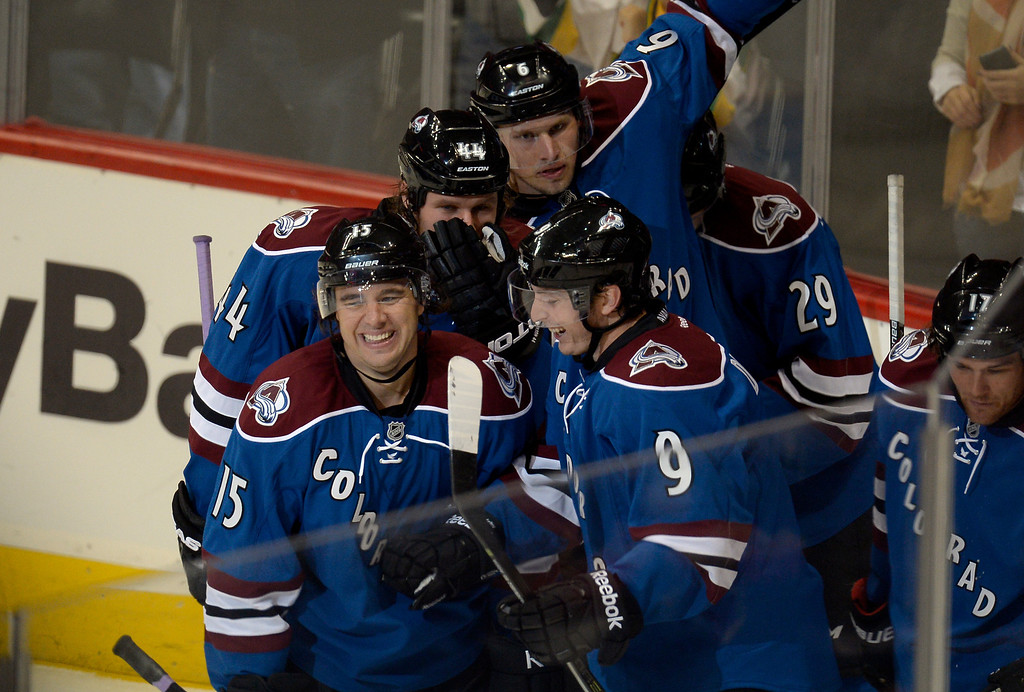 . DENVER, CO - OCTOBER 15: TColorado Avalanche center Matt Duchene (9) smiles with Colorado Avalanche right wing P.A. Parenteau (15) after his second period goal and second goal of the night against the Dallas Stars October 15, 2013 at Pepsi Center.(Photo By John Leyba/The Denver Post)