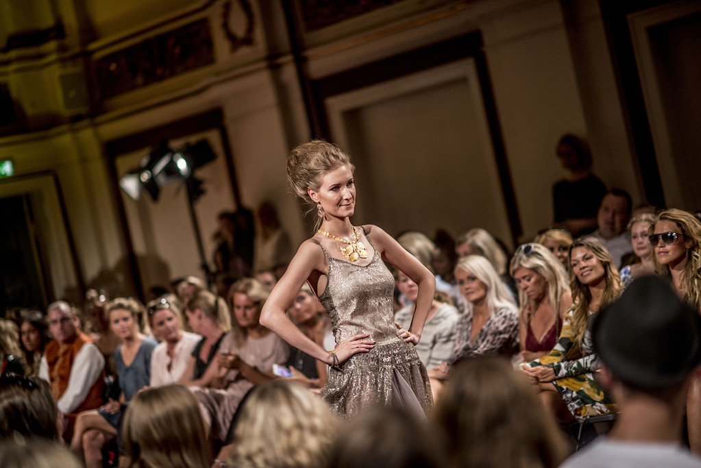 . A model wears an outfit during the JWLSCPH show during Copenhagen Fashion Week Spring/Summer 2014 in Copenhagen on Wednesday, Aug. 7, 2013. (AP Photo/POLFOTO, Anthon Unger)