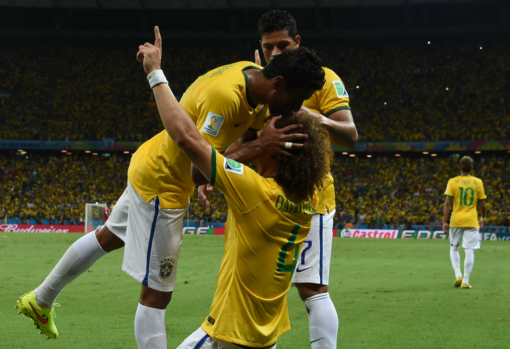 . Brazil\'s defender David Luiz (C) celebrates with teammates after scoring during the quarter-final football match between Brazil and Colombia at the Castelao Stadium in Fortaleza during the 2014 FIFA World Cup on July 4, 2014. VANDERLEI ALMEIDA/AFP/Getty Images