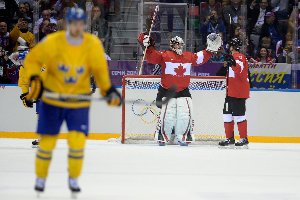 . Dan Hamhuis (5) of Canada and Carey Price (31) celebrate during the third period of Canada\'s 3-0 win in the men\'s ice hockey gold medal game against Sweden. Sochi 2014 Winter Olympics on Sunday, February 23, 2014 at Bolshoy Ice Arena. (Photo by AAron Ontiveroz/ The Denver Post)