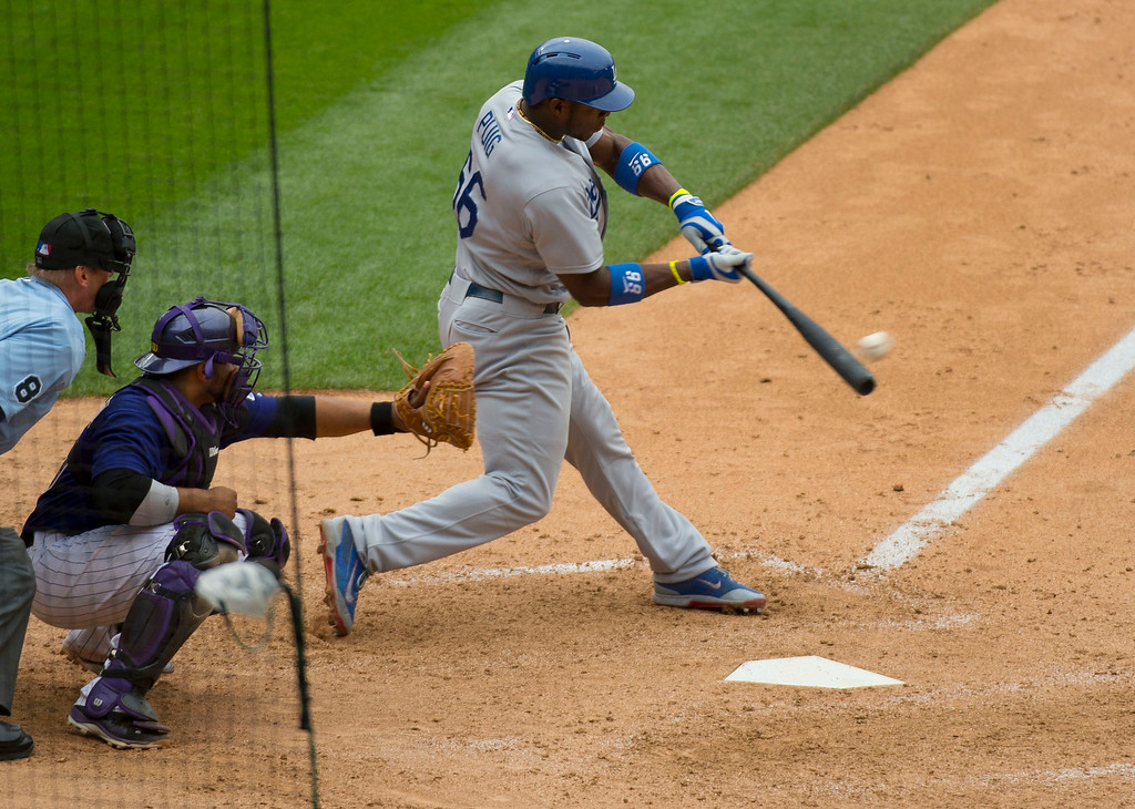 . Los Angeles Dodgers right fielder Yasiel Puig (66) hits s double in the eighth inning against the Colorado Rockies July 6, 2014 at Coors Field. (Photo by John Leyba/The Denver Post)