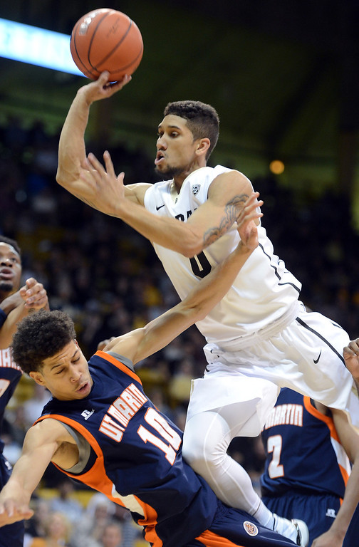 . Askia Booker, right,  of Colorado, gets called for a charge on Chandler Rowe, of Tenn-Martin, during the first half of the NCAA basketball game in Boulder, Colo., Sunday, Nov. 10, 2013. (The Daily Camera/Cliff Grassmick)