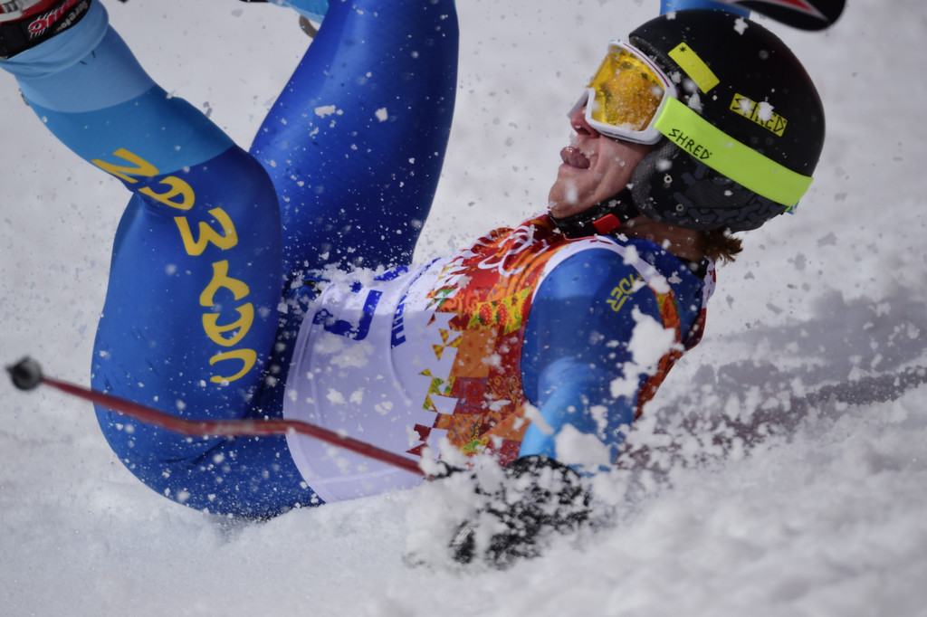 . Cayman Islands\' Dow Travers crashes during the Men\'s Alpine Skiing Giant Slalom Run 1 at the Rosa Khutor Alpine Center during the Sochi Winter Olympics on February 19, 2014.  AFP PHOTO / OLIVIER  MORIN/AFP/Getty Images