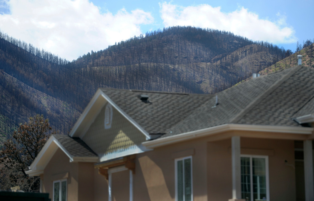 . The charred hillside is the backdrop to new homes under construction in the Parkside subdivision. (Photo By Kathryn Scott Osler/The Denver Post)
