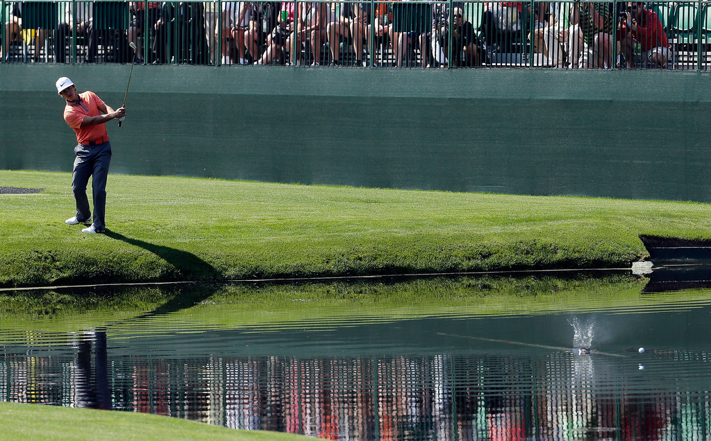 . Thorbjorn Olesen, of Denmark, skips a ball across the water on the 16th hole during a practice round for the Masters golf tournament Wednesday, April 9, 2014, in Augusta, Ga. (AP Photo/Chris Carlson)
