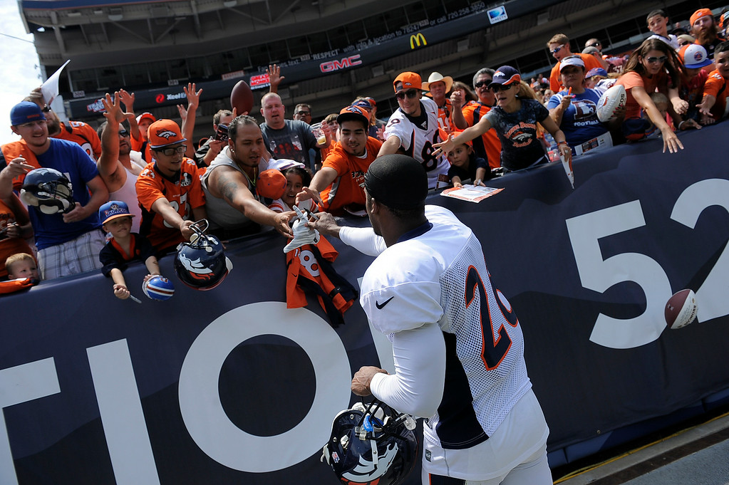 . Denver Broncos free safety Rahim Moore (26) signs autographs after practice on day four of the Denver Broncos 2014 training camp July 27, 2014 at Sports Authority Field at Mile High. (Photo by John Leyba/The Denver Post)