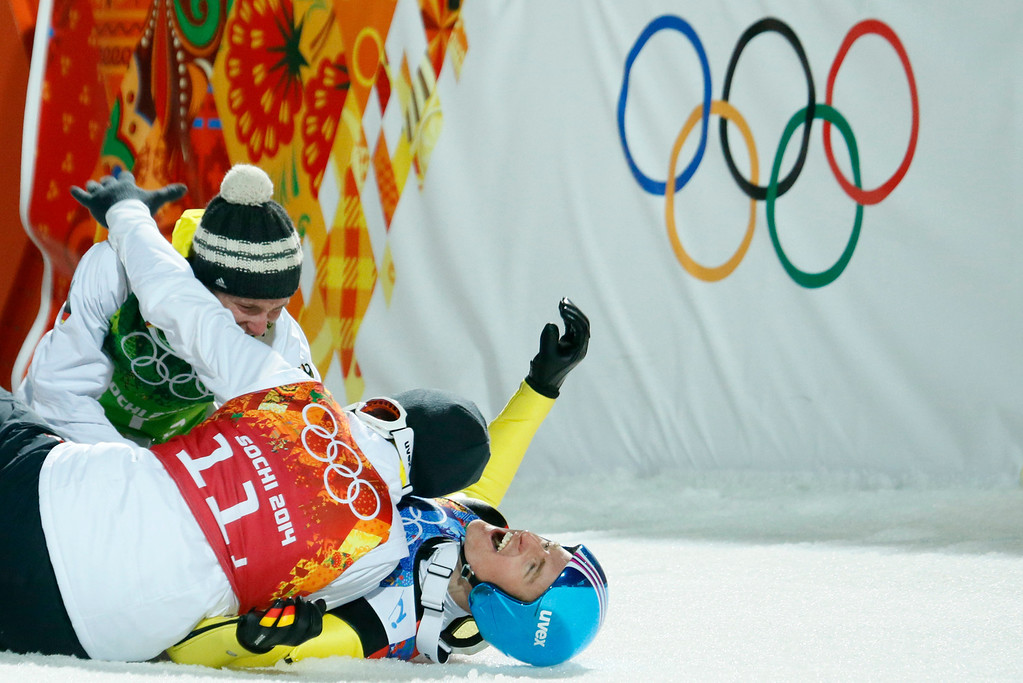 . Germany\'s Severin Freund, bottom,  celebrates with his teammates after winning the gold during the ski jumping large hill team competition at the 2014 Winter Olympics, Monday, Feb. 17, 2014, in Krasnaya Polyana, Russia. (AP Photo/Dmitry Lovetsky)
