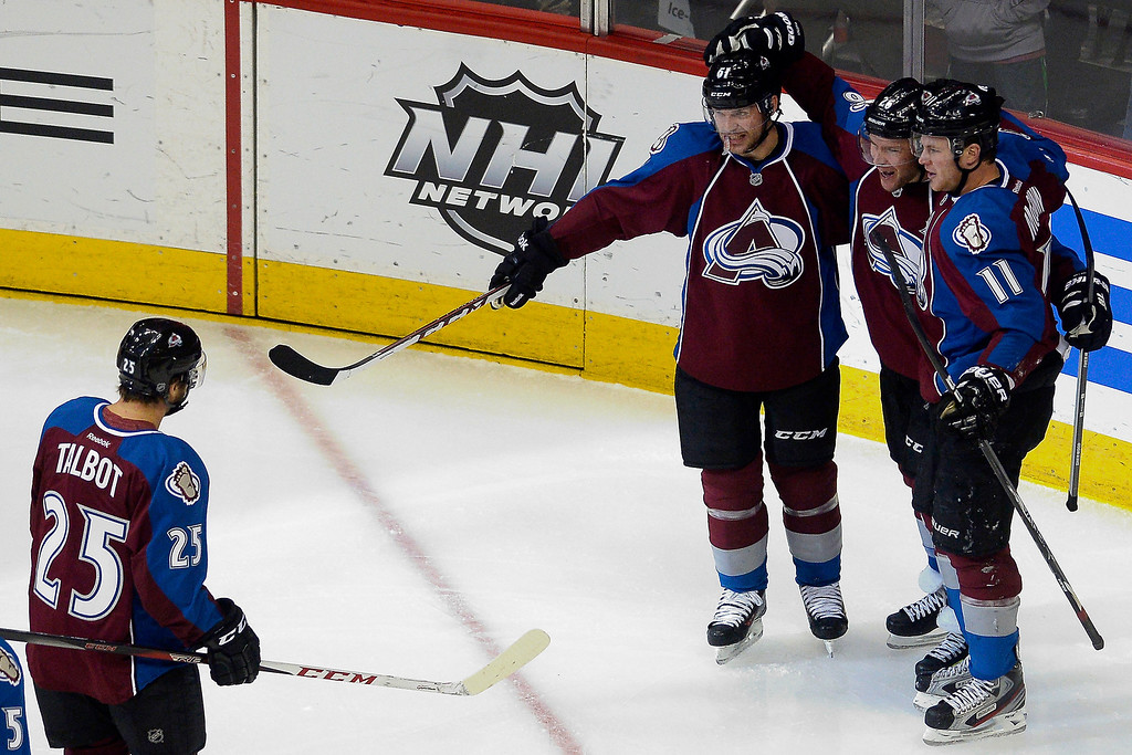 . Colorado Avalanche center Paul Stastny (26) celebrates a goal with teammates left wing Jamie McGinn (11), defenseman Andre Benoit (61) and center Maxime Talbot (25) during the first period. (Photo by AAron Ontiveroz/The Denver Post)