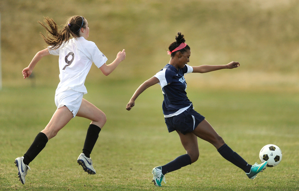 . PARKER, CO. - APRIL 2: Eagles forward Cydney Billups, right, put a shot on net in the first half. The Valor Christian High School girl\'s soccer team defeated Golden 4-1 Wednesday night, April 3, 2013.  Photo By Karl Gehring/The Denver Post)