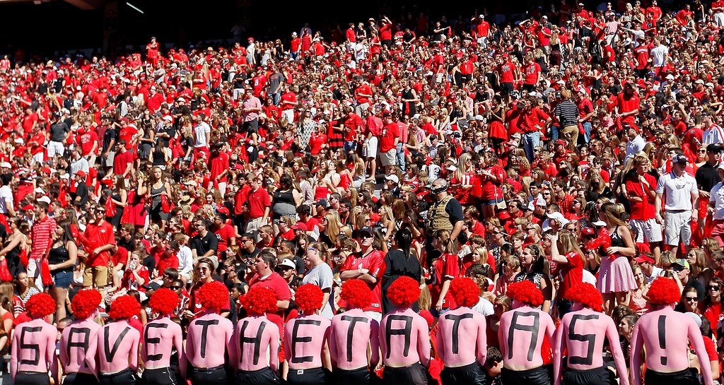 ". Georgia Bulldogs fans supper Breast Cancer Awareness Month with the slogan ""Save The Tatas!\"" on their backs during the game against the Missouri Tigers at Sanford Stadium on October 12, 2013 in Athens, Georgia.  (Photo by Kevin C. Cox/Getty Images)"