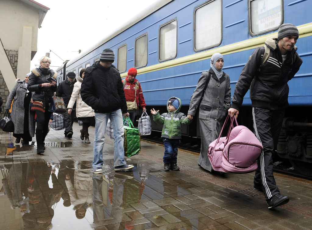 . A family of Crimean Tartars disembarks from a train as they arrive from Simferopol to the western Ukrainian city of Lviv on March 7, 2014. In the city of Lviv, across Ukraine from the crisis gripping Crimea, a group of Tatars fleeing the troubled peninsula disembarks on a train platform looking for security away from Russian forces. YURIY DYACHYSHYN/AFP/Getty Images