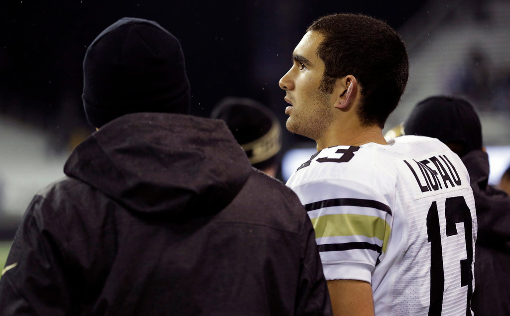 . Colorado quarterback Sefo Liufau (13) stands on the sidelines at the end of the fourth quarter of an NCAA college football game against Washington, Saturday, Nov. 9, 2013, in Seattle. Washington won 59-7. (AP Photo/Ted S. Warren)