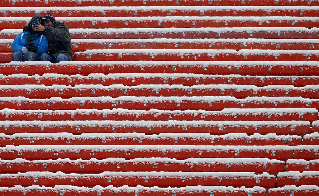 . Fans take a picture at FirstEnergy Stadium before the Cleveland Browns host the Chicago Bears on December 15, 2013 in Cleveland, Ohio.  (Photo by Matt Sullivan/Getty Images)