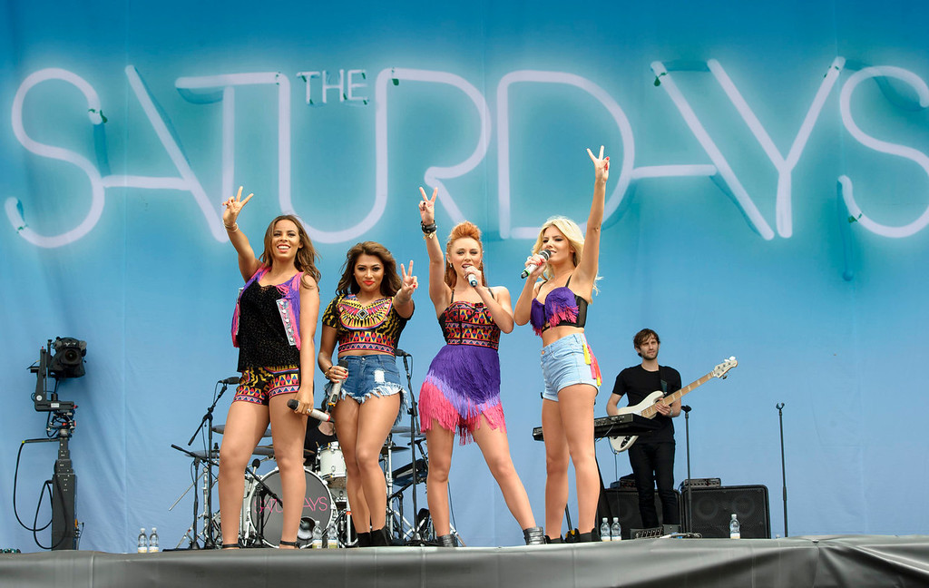 . From left, Rochelle Humes, Vanessa White, Una Healy and Mollie King from British band The Saturdays performs at the V Festival in Chelmsford, England, Sunday, Aug. 18, 2013. (Photo by Jonathan Short/Invision/AP)