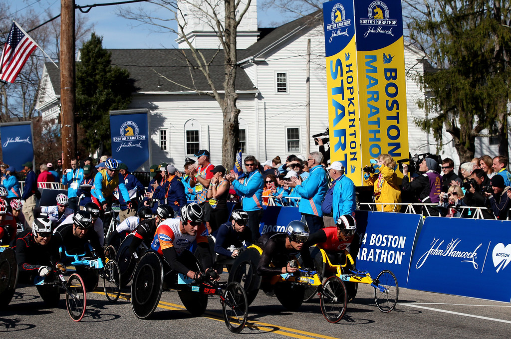 . Members of the Push Rim Wheelchair division start the 118th Boston Marathon on April 21, 2014 in Hopkinton, Massachusetts.  (Photo by Alex Trautwig/Getty Images)