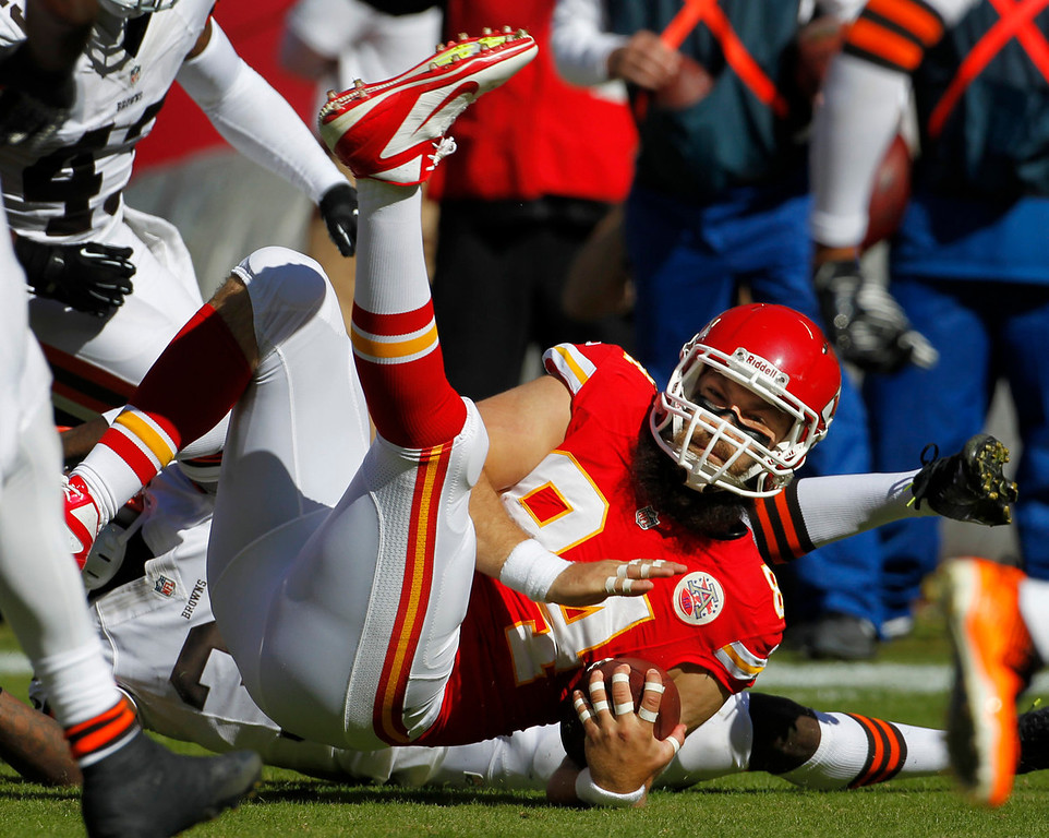 . Kansas City Chiefs tight end Sean McGrath (84) lands on the ground after being hit by Cleveland Browns free safety Tashaun Gipson (39) during the first half of an NFL football game in Kansas City, Mo., Sunday, Oct. 27, 2013. (AP Photo/Colin E. Braley)