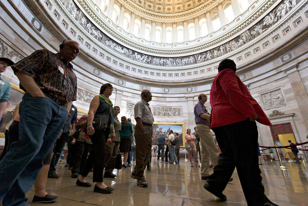 . With hours to go until a possible government shutdown, visitors tour the Rotunda of the. Capitol in Washington, Monday, Sept. 30, 2013. Capitol officials said today that if a shutdown goes into effect, all organized tours of the Capitol and the Capitol Visitors Center will be suspended. (AP Photo/J. Scott Applewhite)