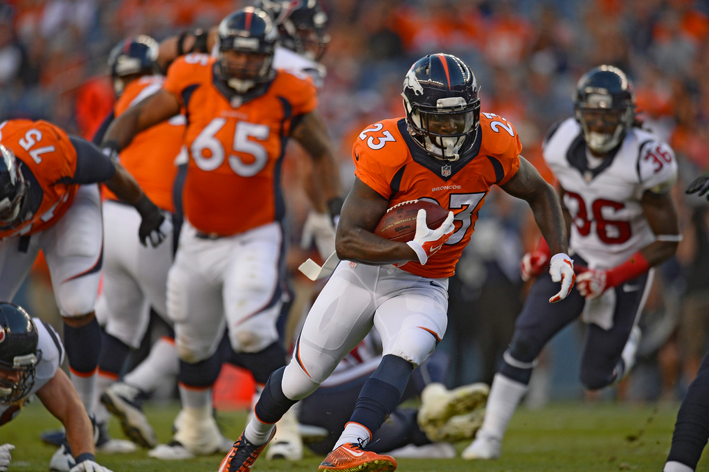 . DENVER, CO - AUGUST 23: Denver Broncos running back Ronnie Hillman (23) picks up a few yards on this carry during the first quarter against the Houston Texans August 23, 2014 at Sports Authority Field at Mile High Stadium. (Photo by Kent Nishimura/The Denver Post)