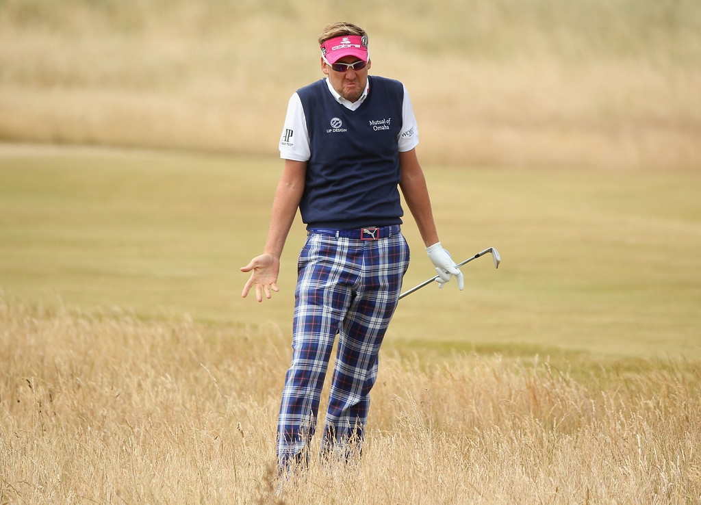 . Ian Poulter of England reacts after hitting his second shot on the 3rd hole during the final round of the 142nd Open Championship at Muirfield on July 21, 2013 in Gullane, Scotland.  (Photo by Andrew Redington/Getty Images)