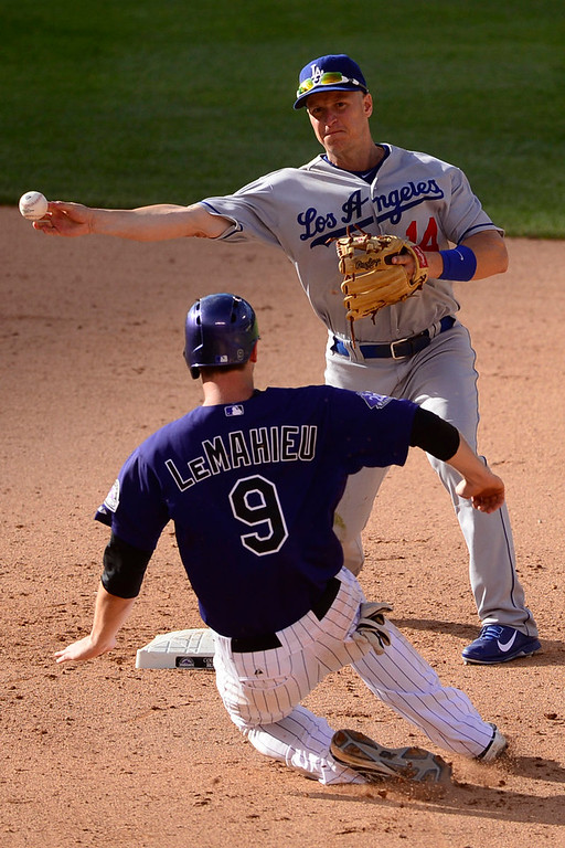 . Mark Ellis (14) of the Los Angeles Dodgers gets out DJ LeMahieu (9) of the Colorado Rockies while forcing a double play on a ball hit by Michael Cuddyer (3) during the Dodgers\' 10-8 win in Denver on Monday, September 2, 2013. The Colorado Rockies hosted the Los Angeles Dodgers at Coors Field. (Photo by AAron Ontiveroz/The Denver Post)
