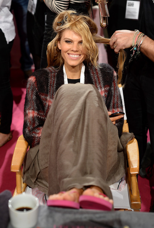 . Model Maryna Linchuk prepares at the 2013 Victoria\'s Secret Fashion Show hair and make-up room at Lexington Avenue Armory on November 13, 2013 in New York City.  (Photo by Dimitrios Kambouris/Getty Images for Victoria\'s Secret)
