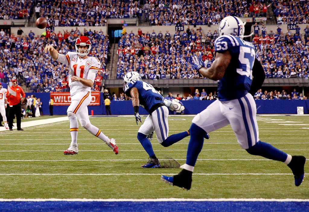 . INDIANAPOLIS, IN - JANUARY 04:  Quarterback Alex Smith #11 of the Kansas City Chiefs passes against the Indianapolis Colts during a Wild Card Playoff game at Lucas Oil Stadium on January 4, 2014 in Indianapolis, Indiana.  (Photo by Rob Carr/Getty Images)