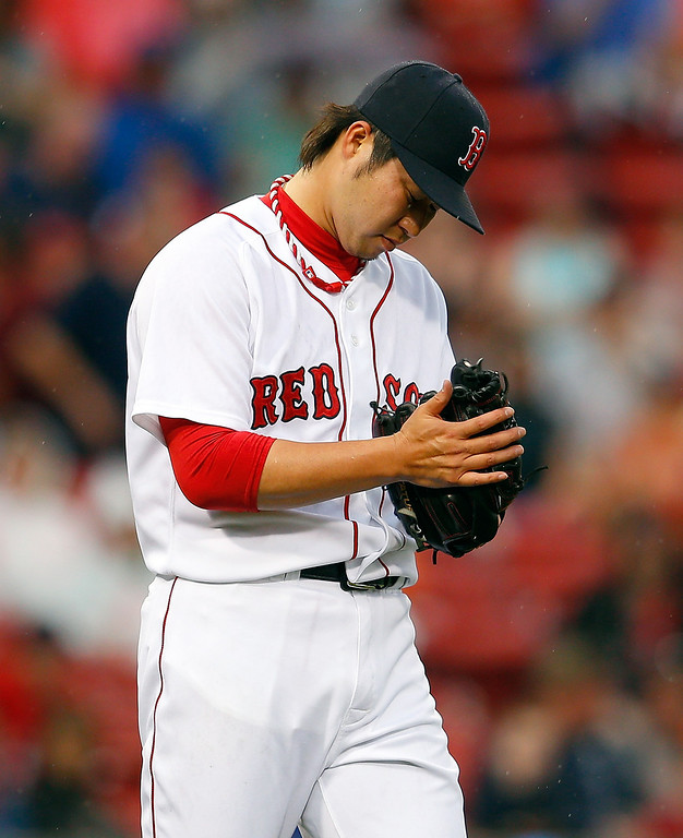 . Junichi Tazawa #36 of the Boston Red Sox reacts after giving up a home run in the 8th inning against the Colorado Rockies at Fenway Park on June 26, 2013 in Boston, Massachusetts.  (Photo by Jim Rogash/Getty Images)