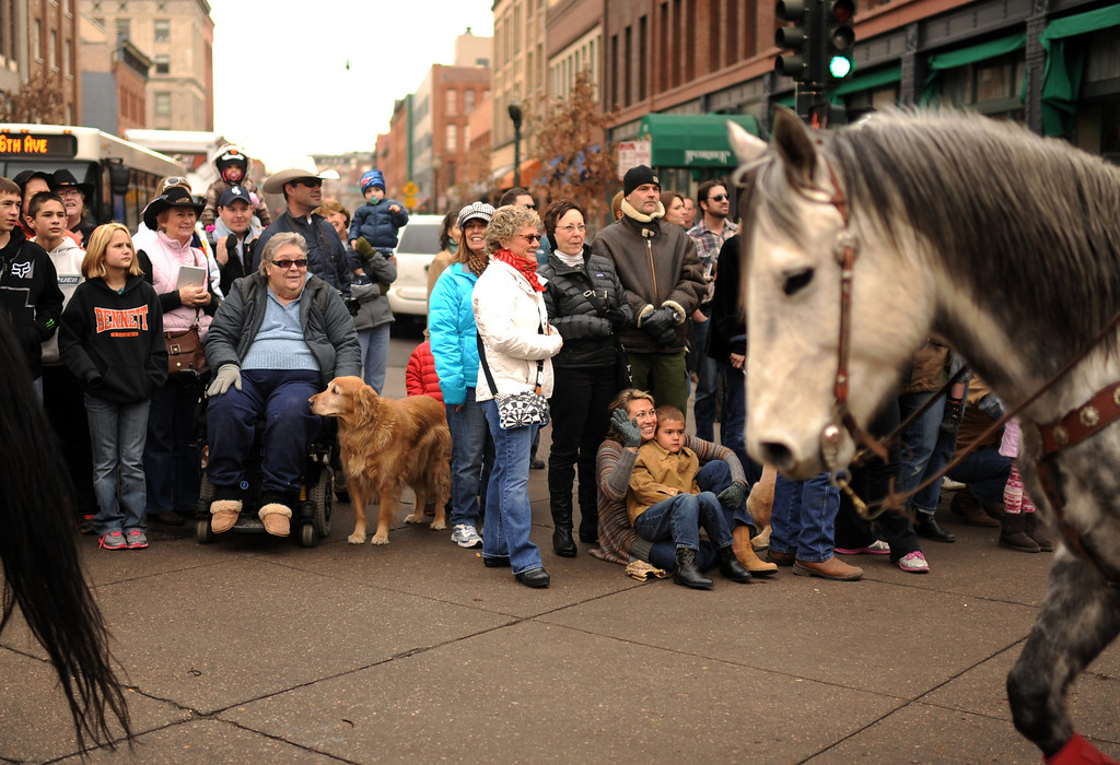 . People celebrate 107th National Western Stock Show Kick-Off Parade at Downtown Denver on Thursday. Denver, CO, January 10, 2013.  Hyoung Chang, The Denver Post