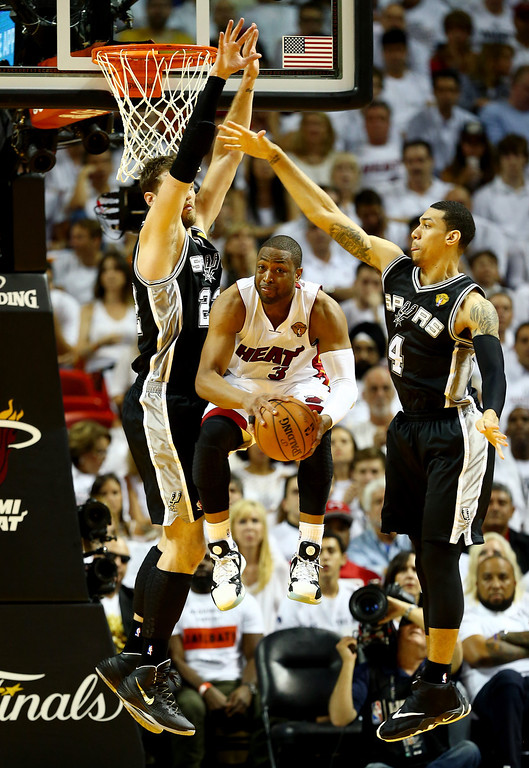 . MIAMI, FL - JUNE 10: Dwyane Wade #3 of the Miami Heat goes to the basket as Tiago Splitter #22 and Danny Green #4 of the San Antonio Spurs defend during Game Three of the 2014 NBA Finals at American Airlines Arena on June 10, 2014 in Miami, Florida.  (Photo by Andy Lyons/Getty Images)