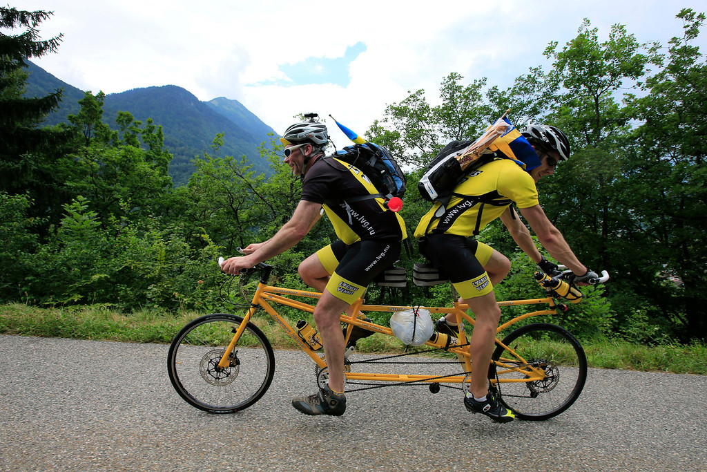 . Sweden\'s Ake Johansson, left, and a friend climb L\'Epine pass on a self-made tandem bicycle during the nineteenth stage of the Tour de France cycling race over 204.5 kilometers (127.8 miles) with start in in Bourg-d\'Oisans and finish in Le Grand-Bornand, France, Friday July 19 2013. (AP Photo/Peter Dejong)