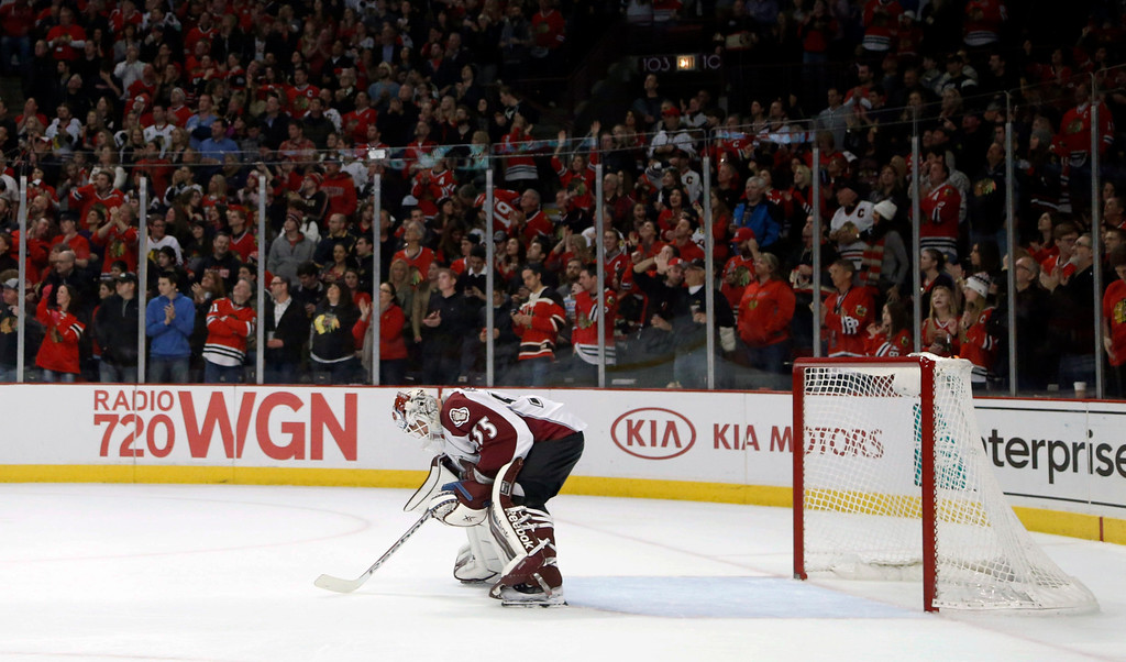 . Colorado Avalanche goalie Jean-Sebastien Giguere drops his head after giving up his sixth goal of the game to Chicago Blackhawks center Michal Handzus during the second period of an NHL hockey game Friday, Dec. 27, 2013, in Chicago. (AP Photo/Charles Rex Arbogast)