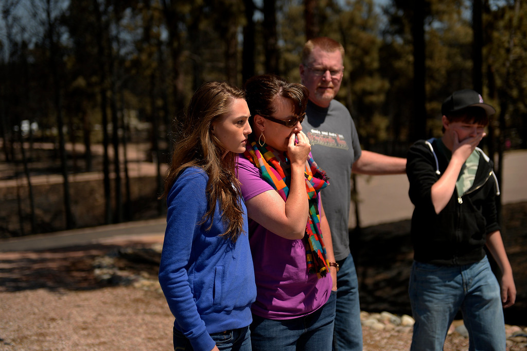 . COLORADO SPRINGS, CO. - June 19: The Schultz family Annissa 20, her mom Camla, dad Mike and brother Nolan 16 look at the totality of the destruction of their home of 8 years as more residents were allowed back to see their homes that were burned in the Black Forest Fire area near Colorado Springs, Colorado. June 19, 2013 Colorado Springs. (Photo By Joe Amon/The Denver Post)