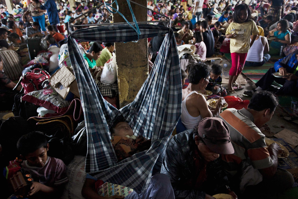 . Villagers are seen in a temporary evacuation shelter at Tiga Binanga village on November 26, 2013 in Karo District, North Sumatra, Indonesia. (Photo by Ulet Ifansasti/Getty Images)
