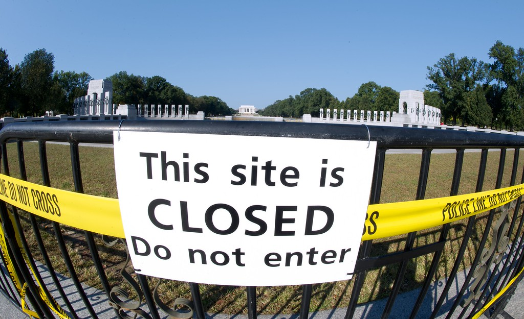 . A closure sign at the front of the World War II Memorial October 2, 2013 in Washington, DC. Veterans groups continue to visit the various war memorials even though they have been shuttered by the government shutdown.  AFP PHOTO / Karen BLEIER/AFP/Getty Images