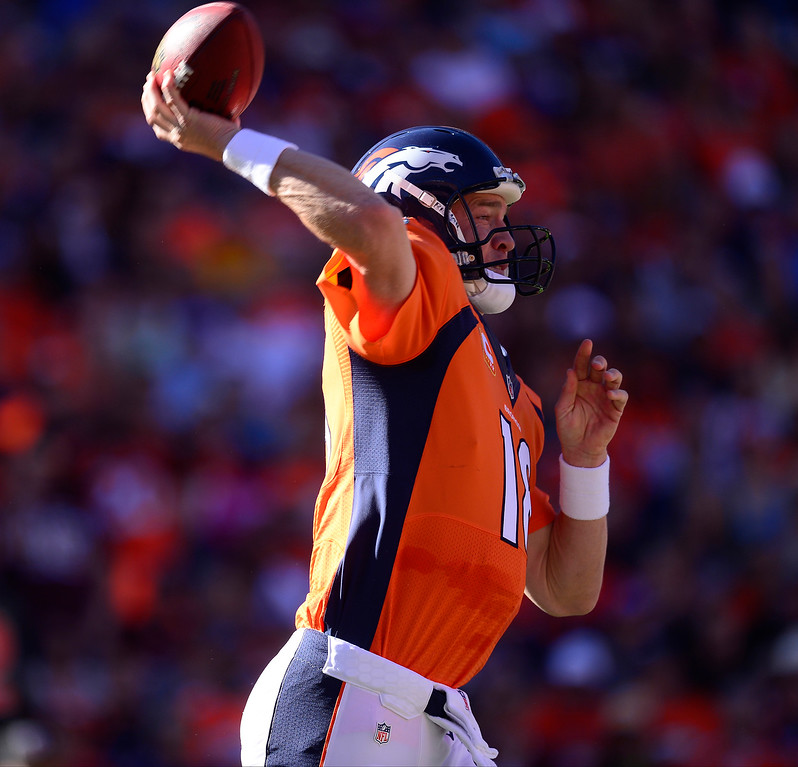 . Denver Broncos quarterback Peyton Manning (18) makes a pass in the first quarter against the Redskins.  (Photo by AAron Ontiveroz/The Denver Post)