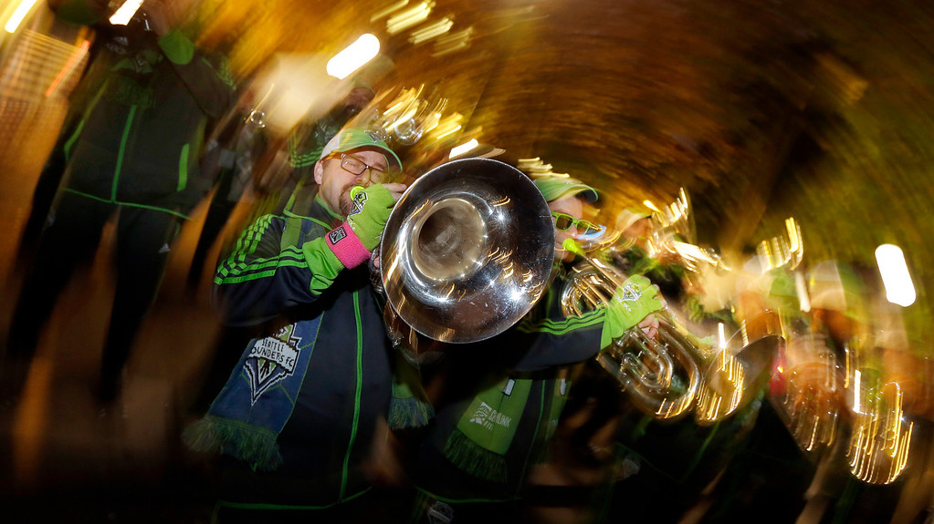 . Members of Sound Wave, the Seattle Sounders marching band, perform at a fan rally before a knockout-round match against the Colorado Rapids in the MLS Cup soccer playoffs Wednesday, Oct. 30, 2013, in Seattle. (AP Photo/Ted S. Warren)